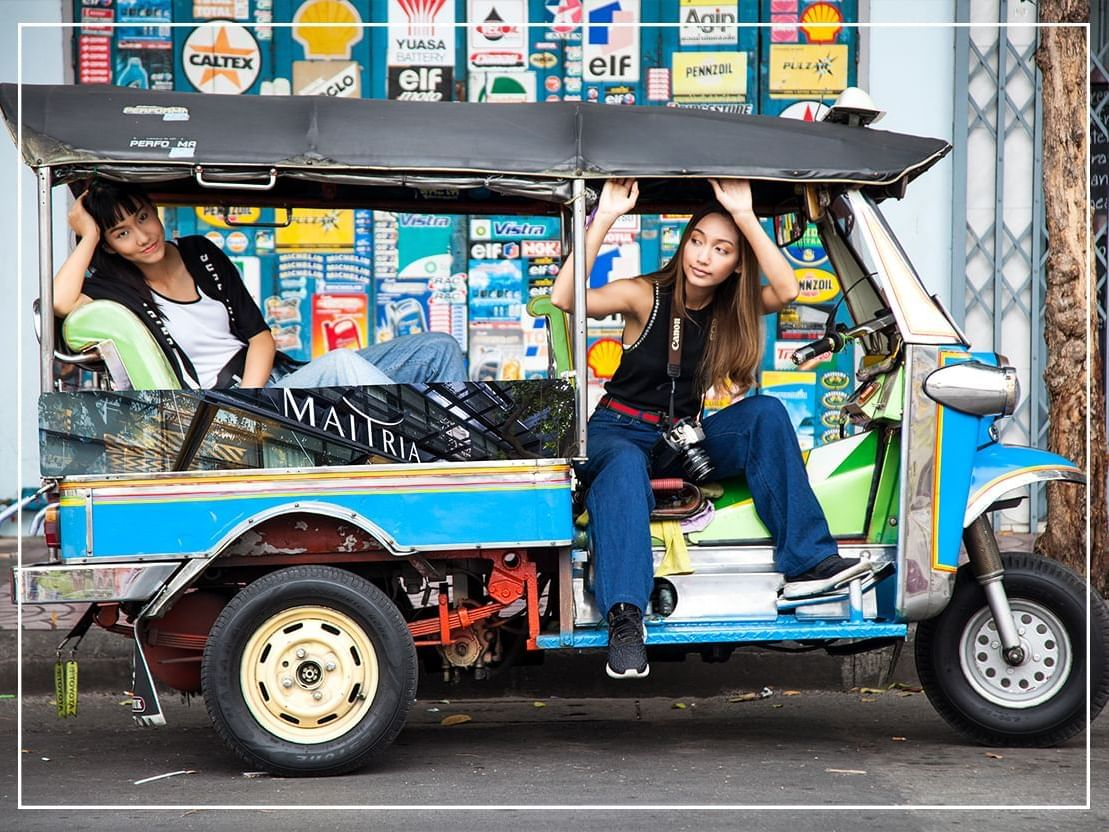 Two ladies at a three wheel near Chatrium Hotel