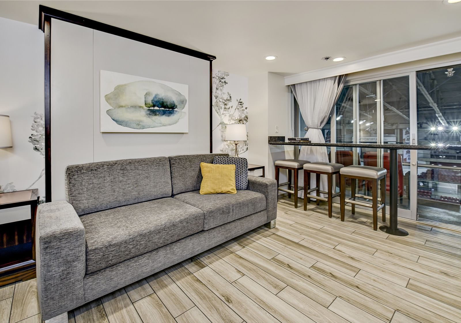 a couch and seating area in a hotel room