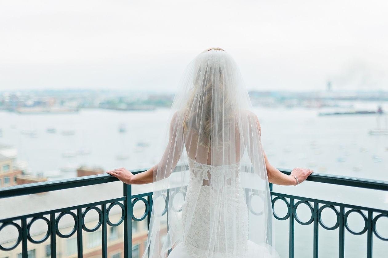 Bride in gown overlooking Boston Harbor