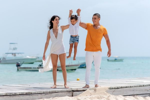 A family playing on beach at The Reef Coco Beach