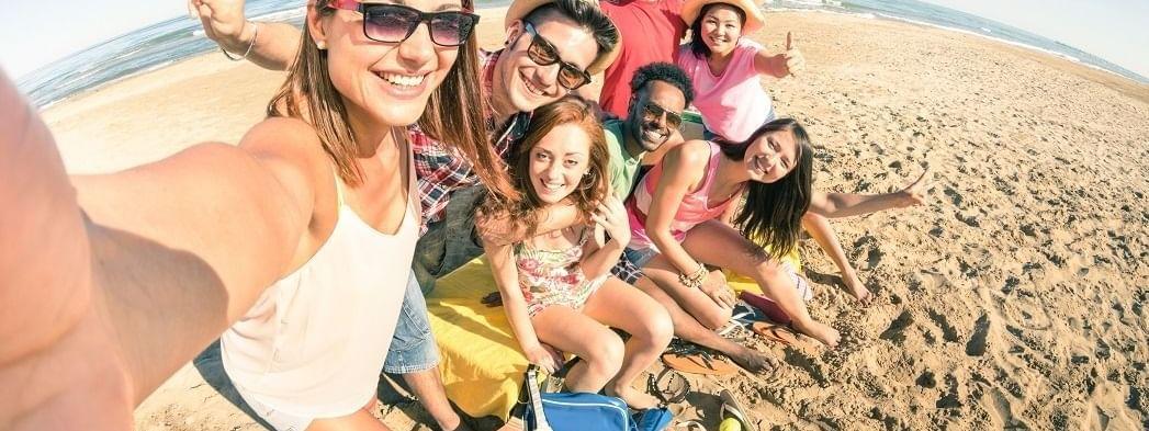 Friends posing to a selfie on beach at Daydream Island Resort
