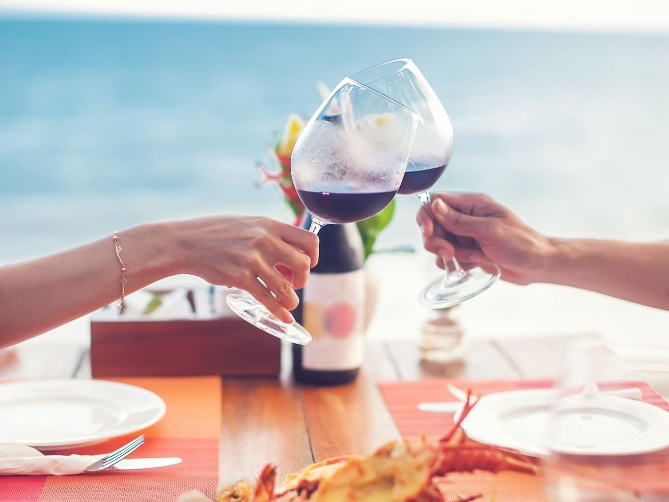 Two people having toast with wine at Daydream Island Resort