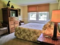 Guest room with TV at Waimea Plantation Cottages