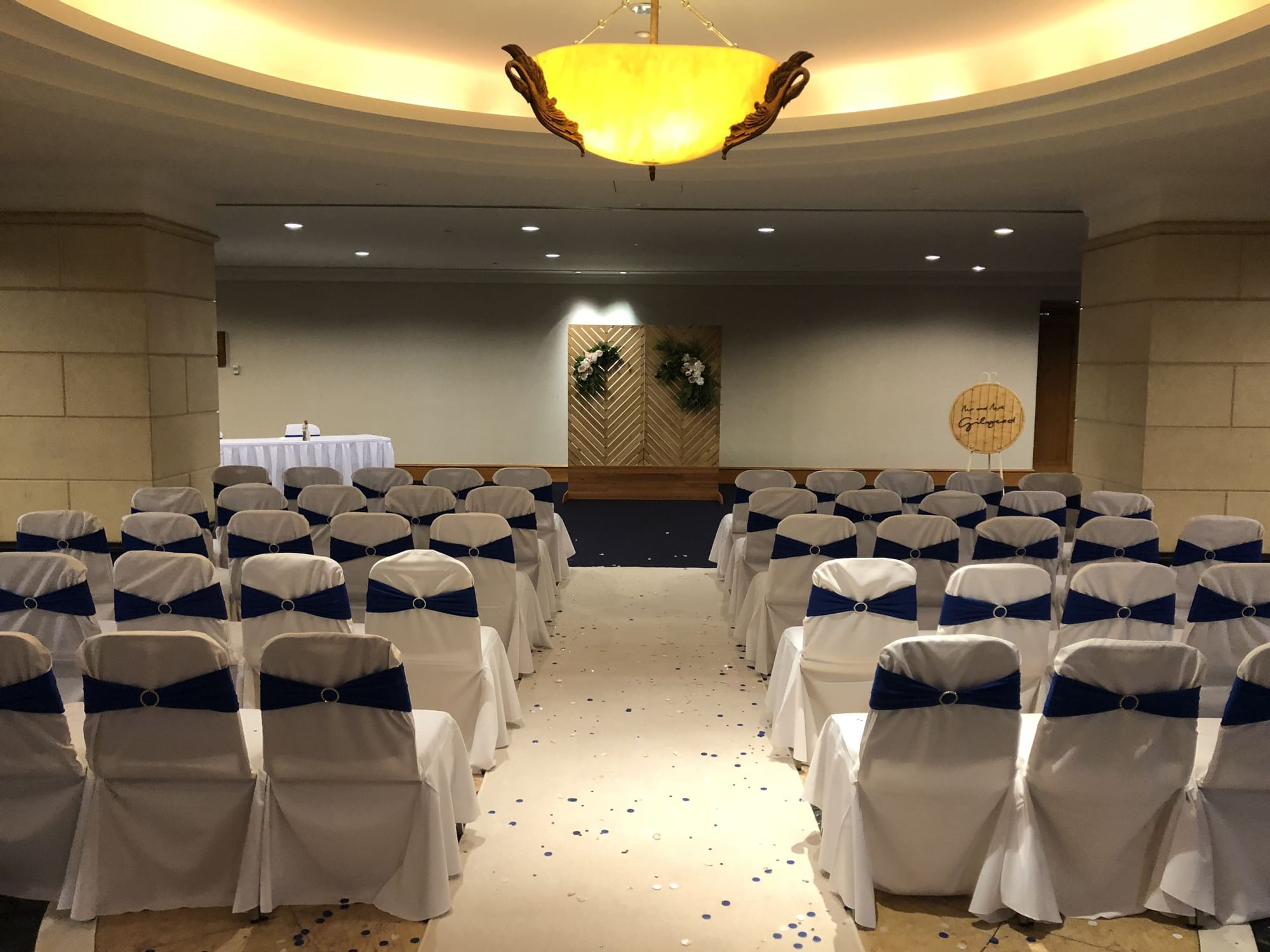 A wedding reception with white chairs at the Duxton Hotel Perth