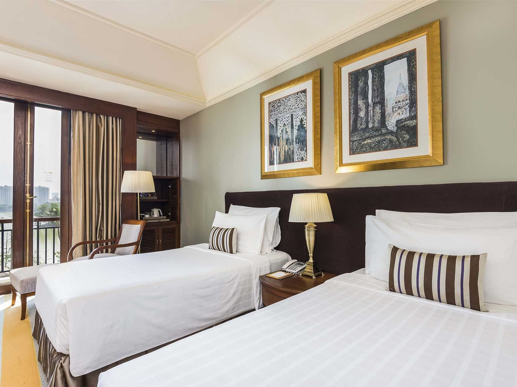 View of beds in Grand Deluxe Room with Lake Or Pagoda View at Chatrium Hotel Royal Lake