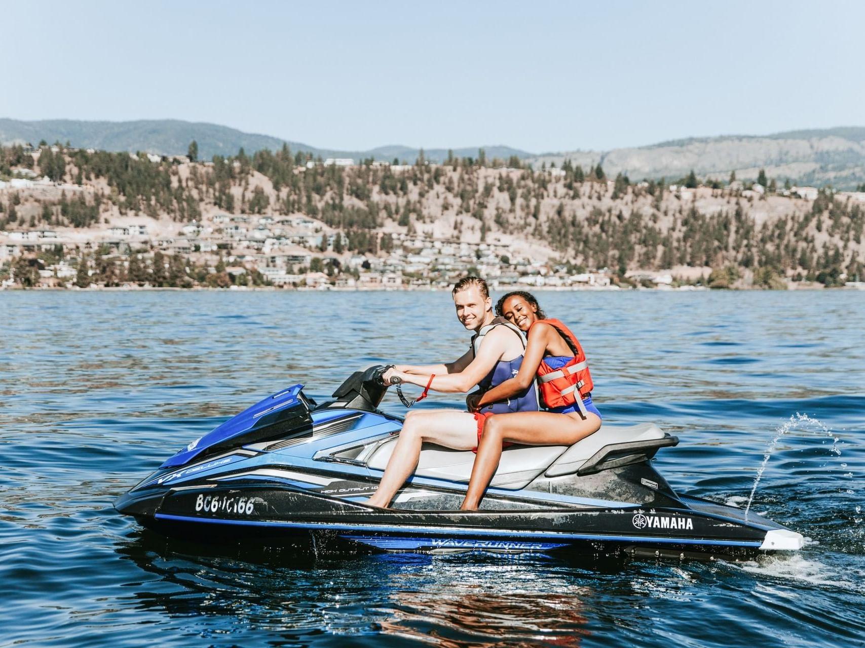 A couple on a jet ski near Manteo Resort