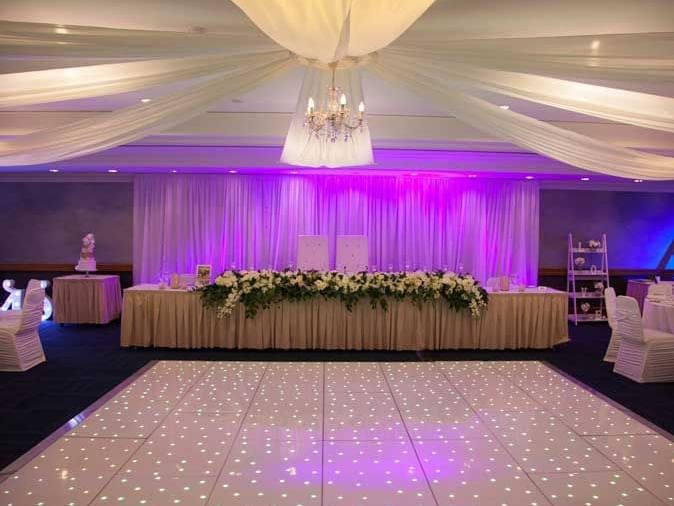 A wedding reception decorated with lights at Duxton Hotel Perth