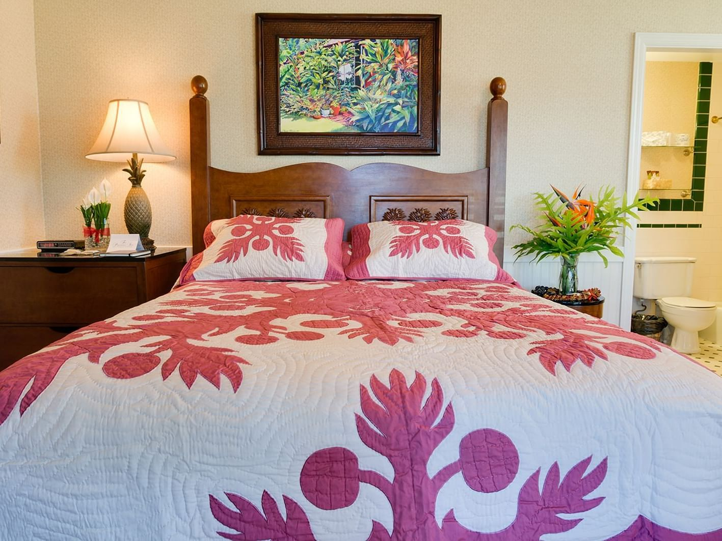 pink bed in tropical room