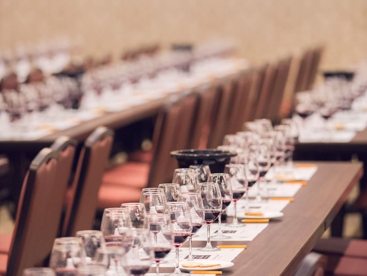 Meeting room tables set with wine glasses