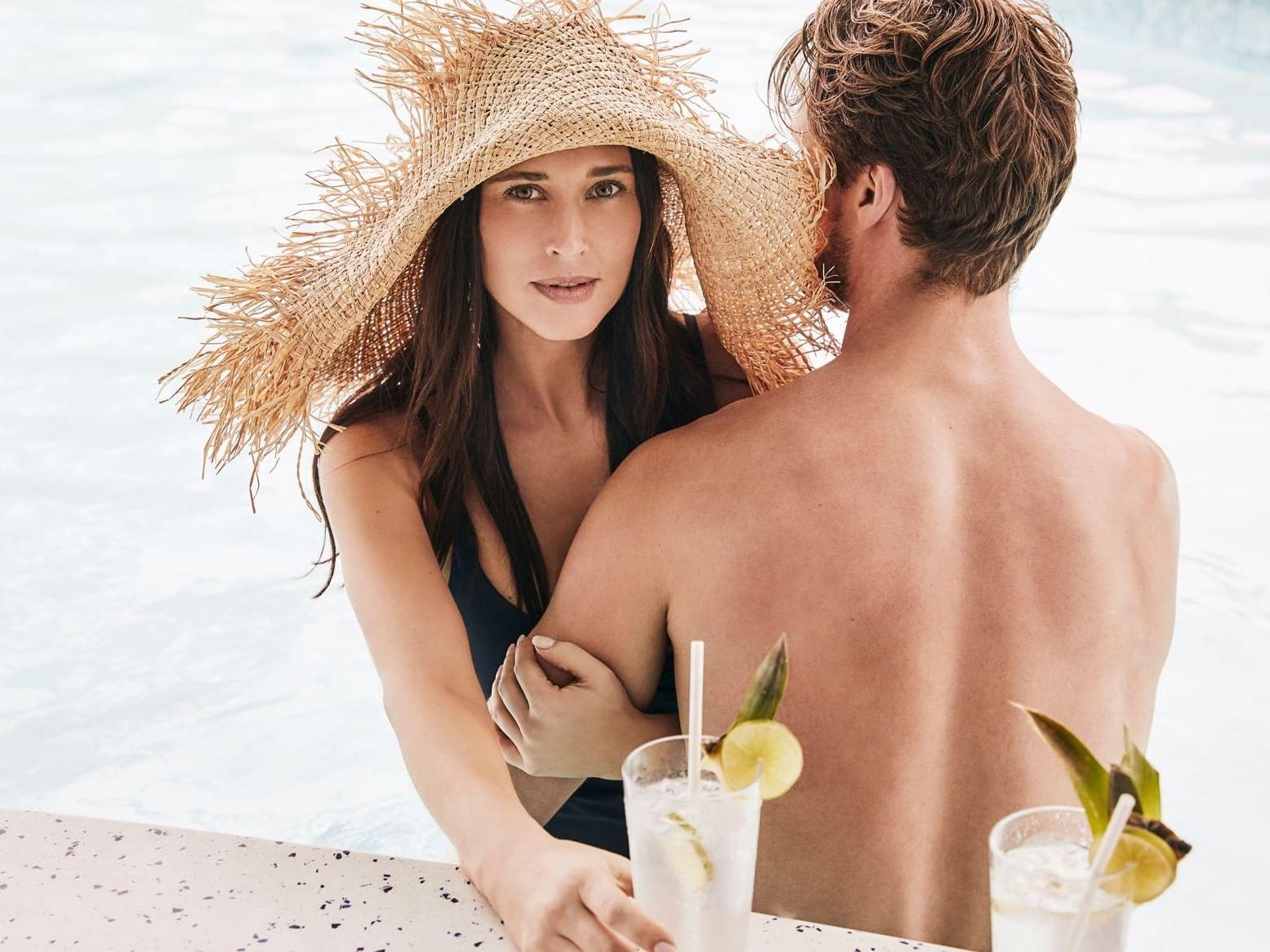 A couple having drinks at Barefoot bar at Daydream Island Resort