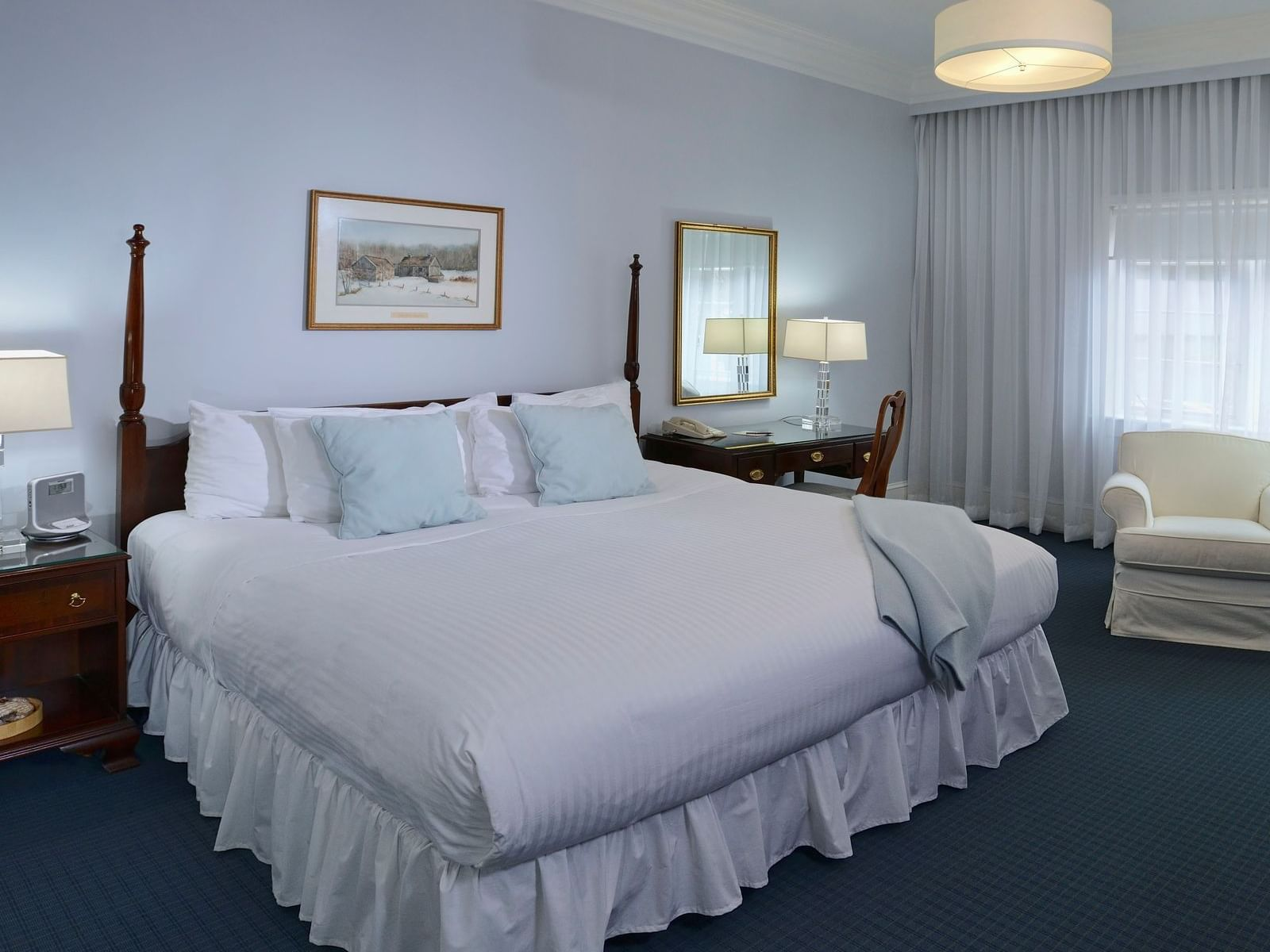 View of Luxury King with king bed at Avon Old Farms Hotel