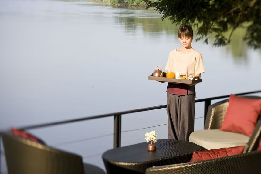 A waitress serving at U Hotels & Resorts