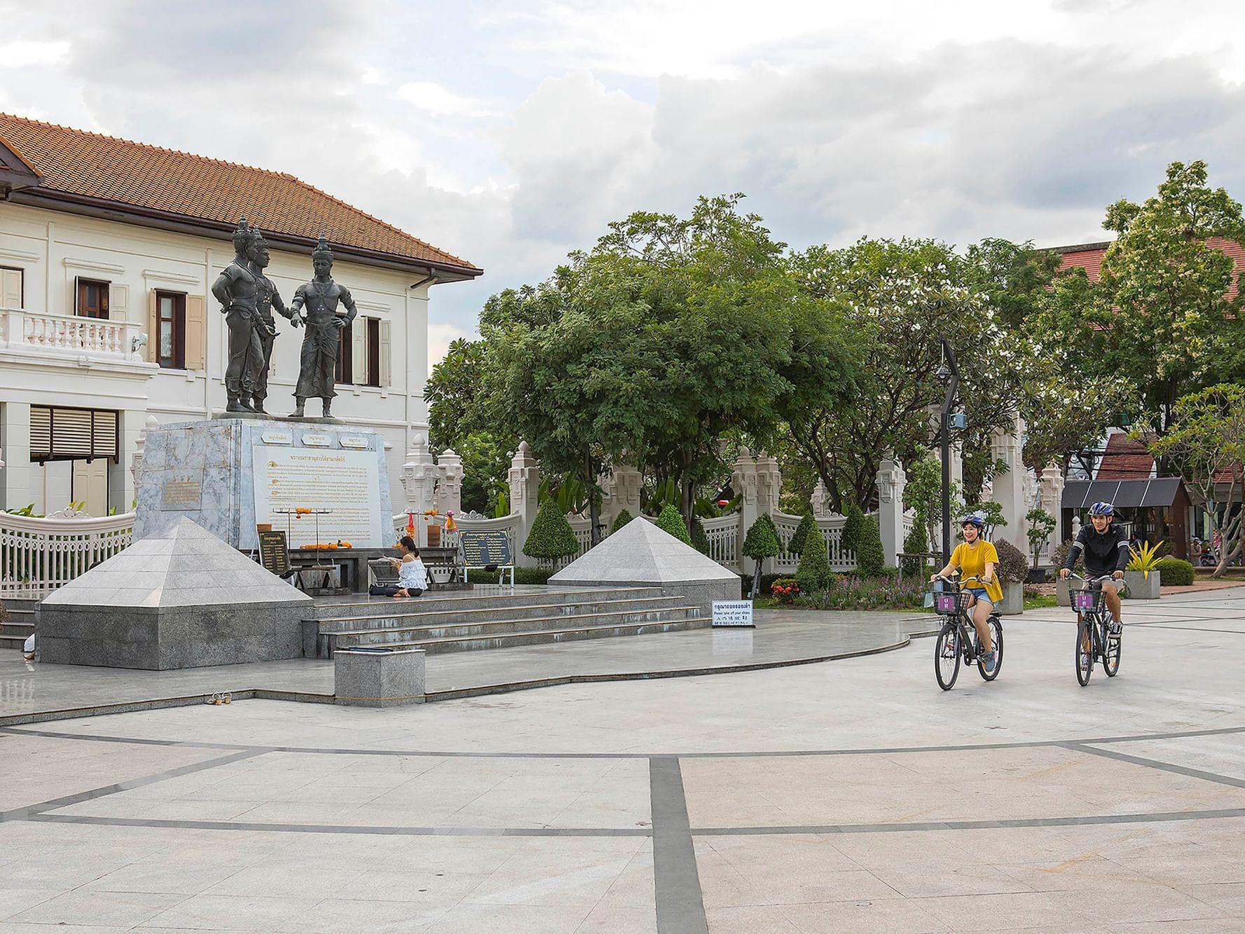 A couple riding free bikes at U Hotels and Resorts