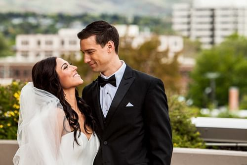 a groom looking at his bride