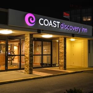 Exterior of Coast Discovery Inn at night