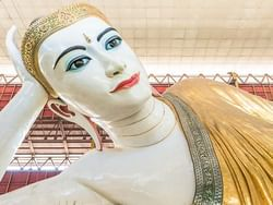 Huge statue of Buddha in Shwedagon Pagoda near Chatrium Hotel Royal Lake Yangon