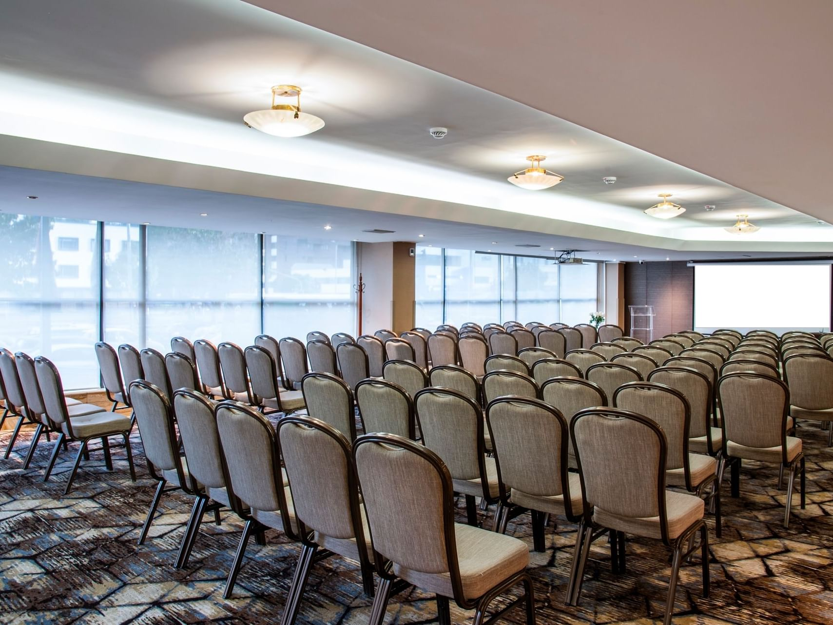 La Candelaria room arranged with chairs at Bogota Plaza Hotel