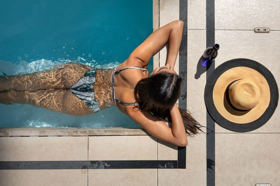 women enjoying the sunshine in a swimming pool at Pepperclub Hotel