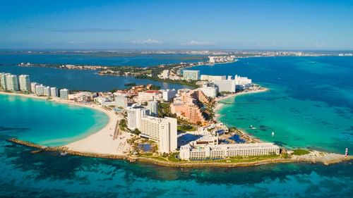 Aerial view of Cancun city with buildings near The Reef Resorts