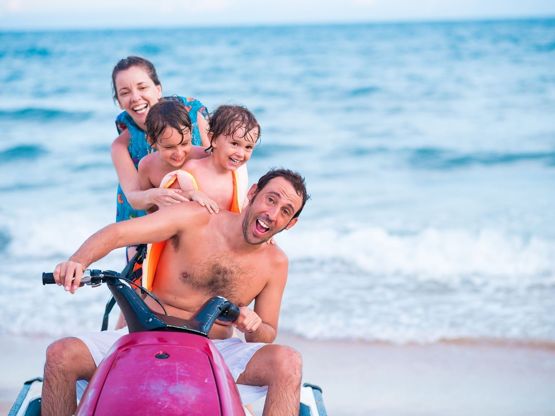 Family riding on jet ski at Daydream Island Resort