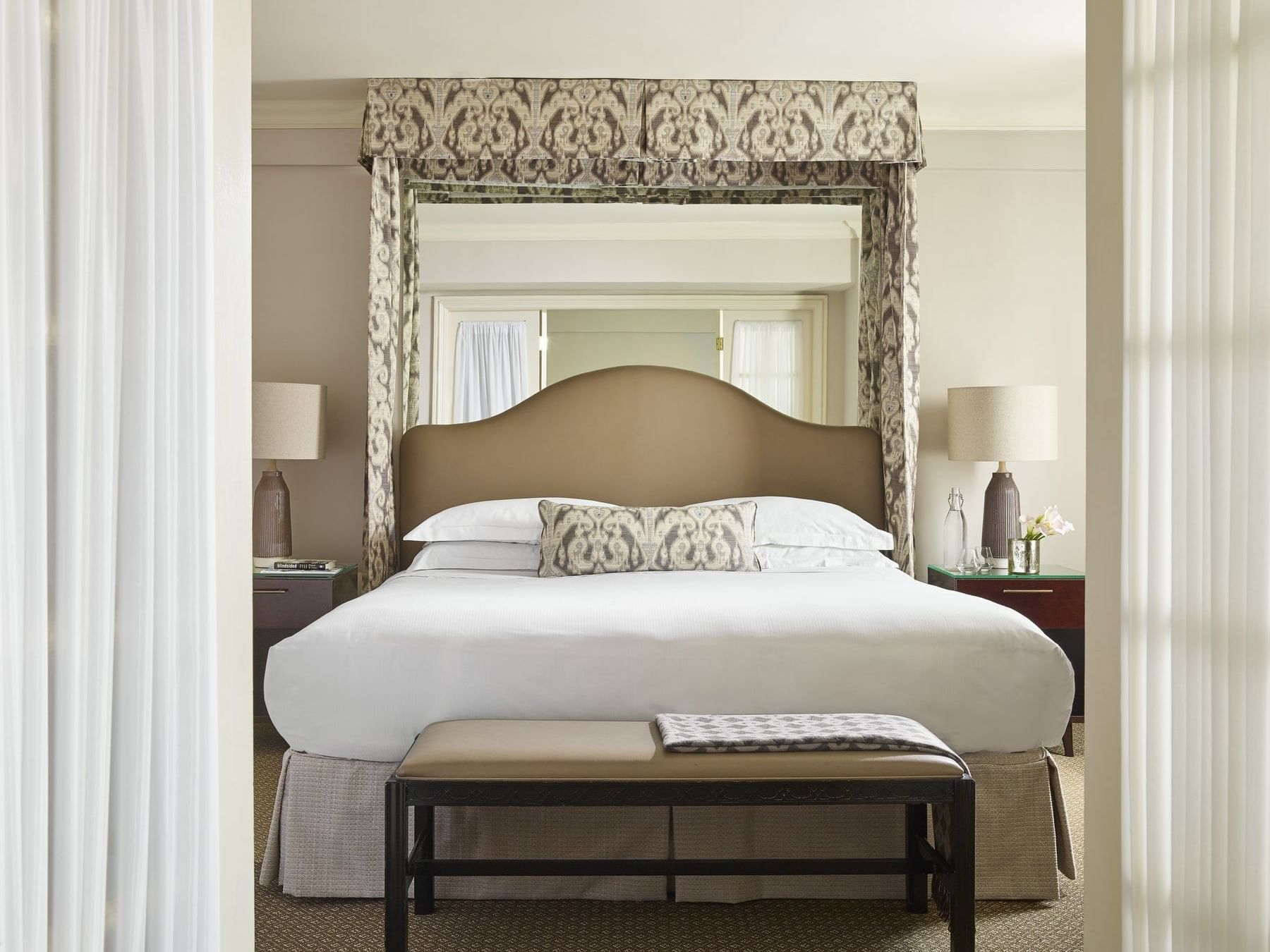 One bedroom suite with one king or queen bed in the bedroom, separated by French doors from a living room.