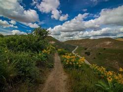 a dirt path running across some hills