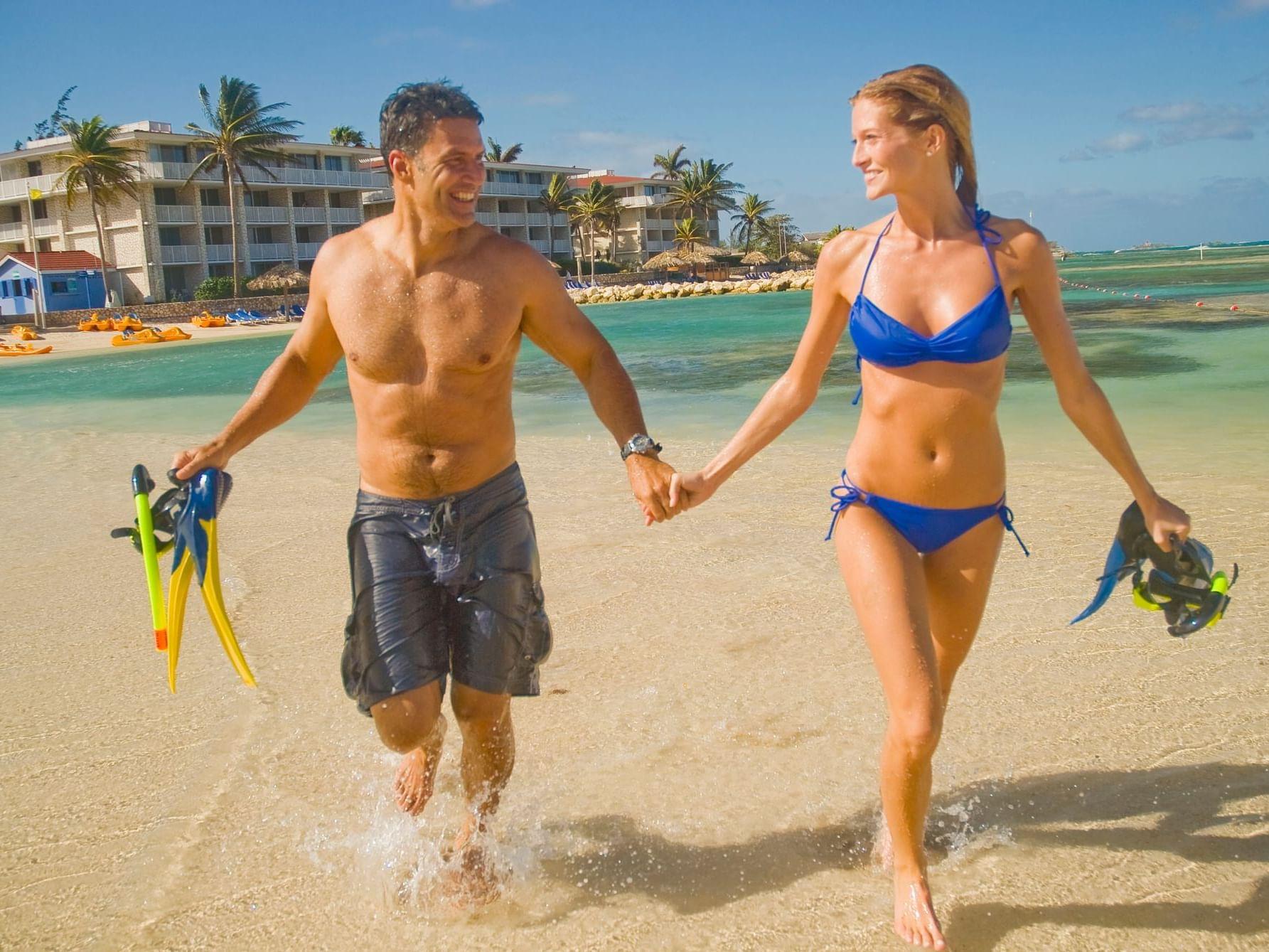 Couple holding hands on beach near Holiday Inn Montego Bay
