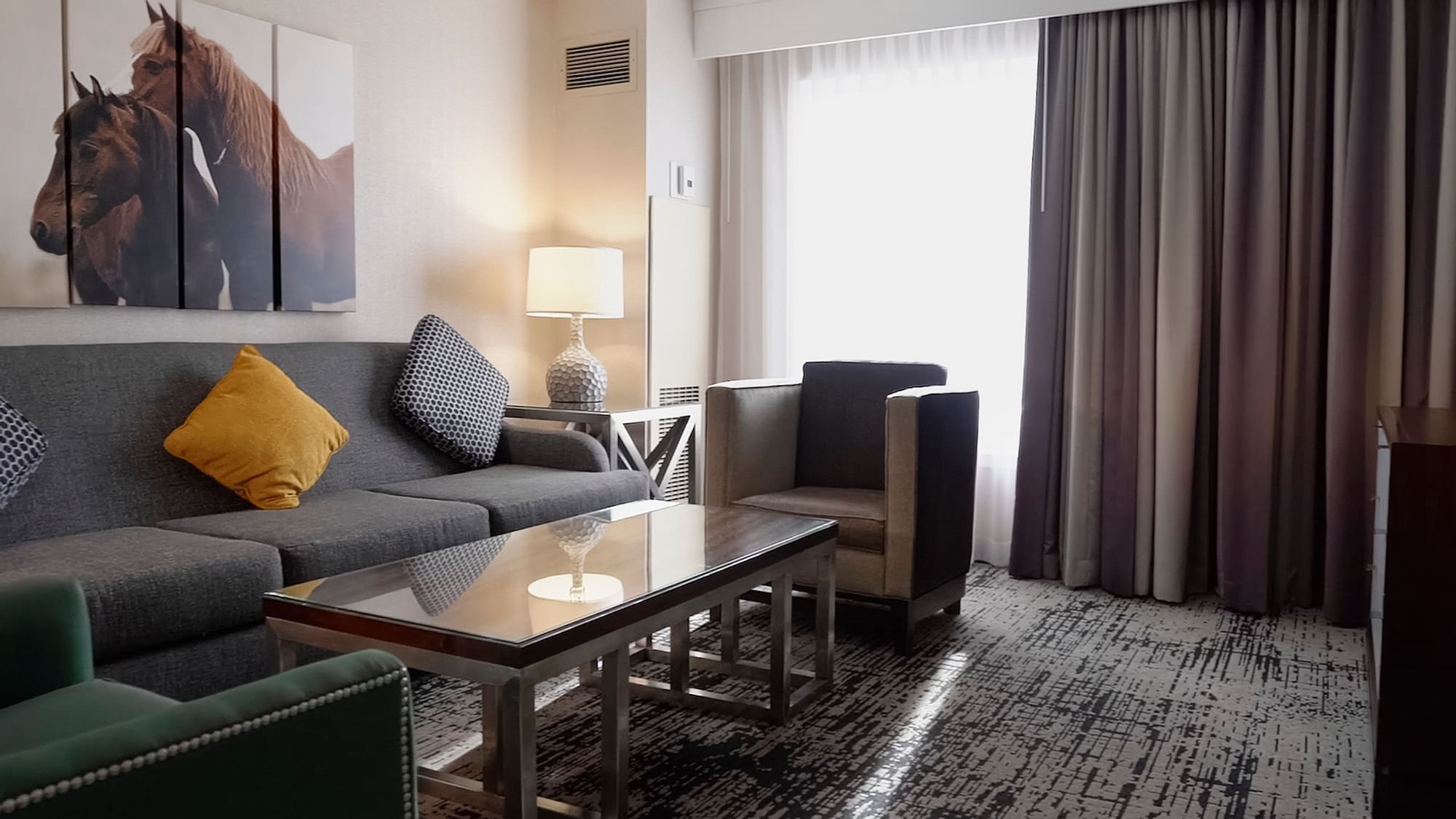 a couch and chairs in a hotel room