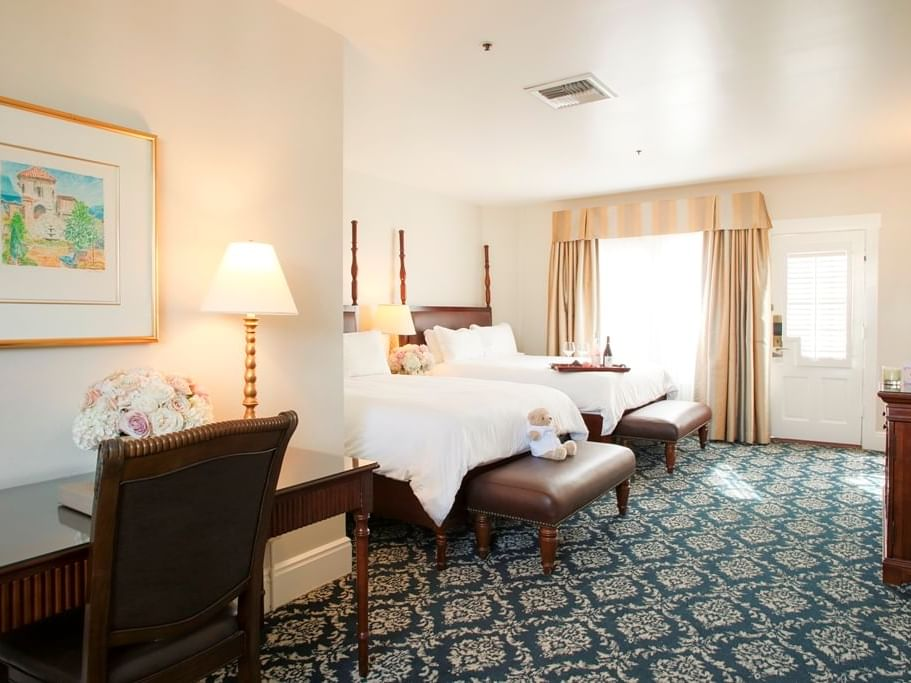 room with two double beds and desk