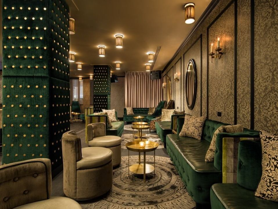 Seating area in the Rickey bar & lounge at Dream Midtown NYC