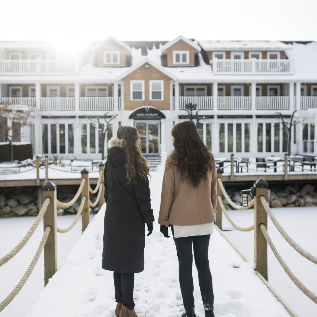 Two ladies at the docks near Manteo Resort during winter