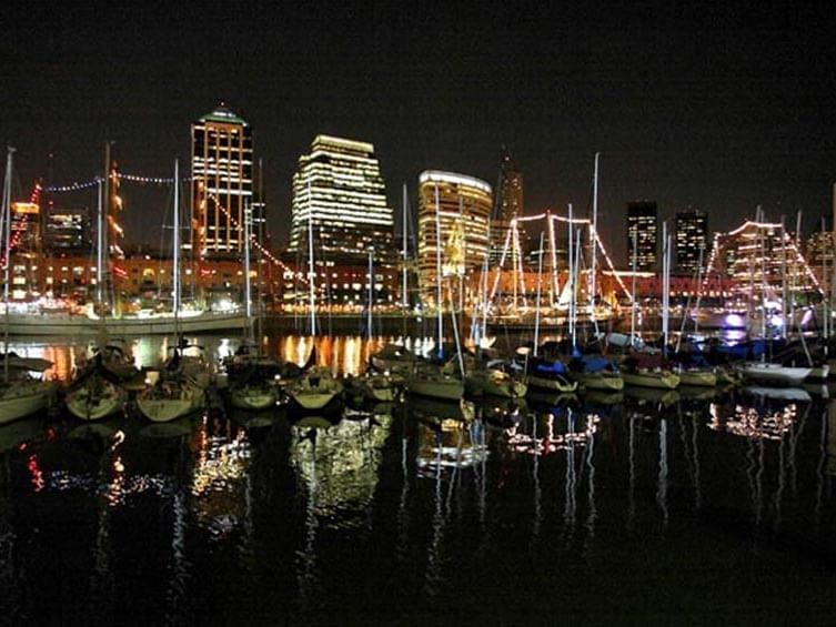 Exterior view of Puerto Madero Harbor at night with city lights near Hotel Emperador Buenos Aires