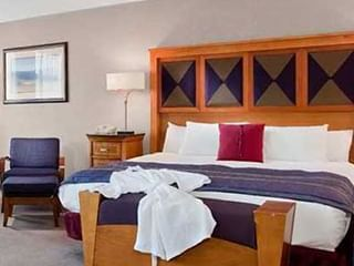 large bed in carpeted hotel room