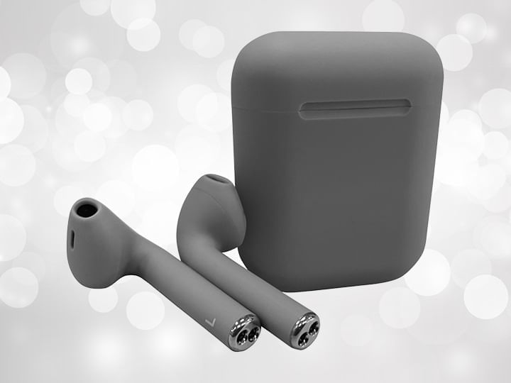 Grey wireless earbuds and case against a silver background