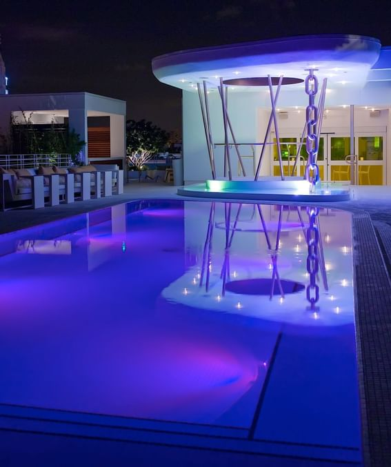 Night time dining & lounge with pool area at Dream south beach.