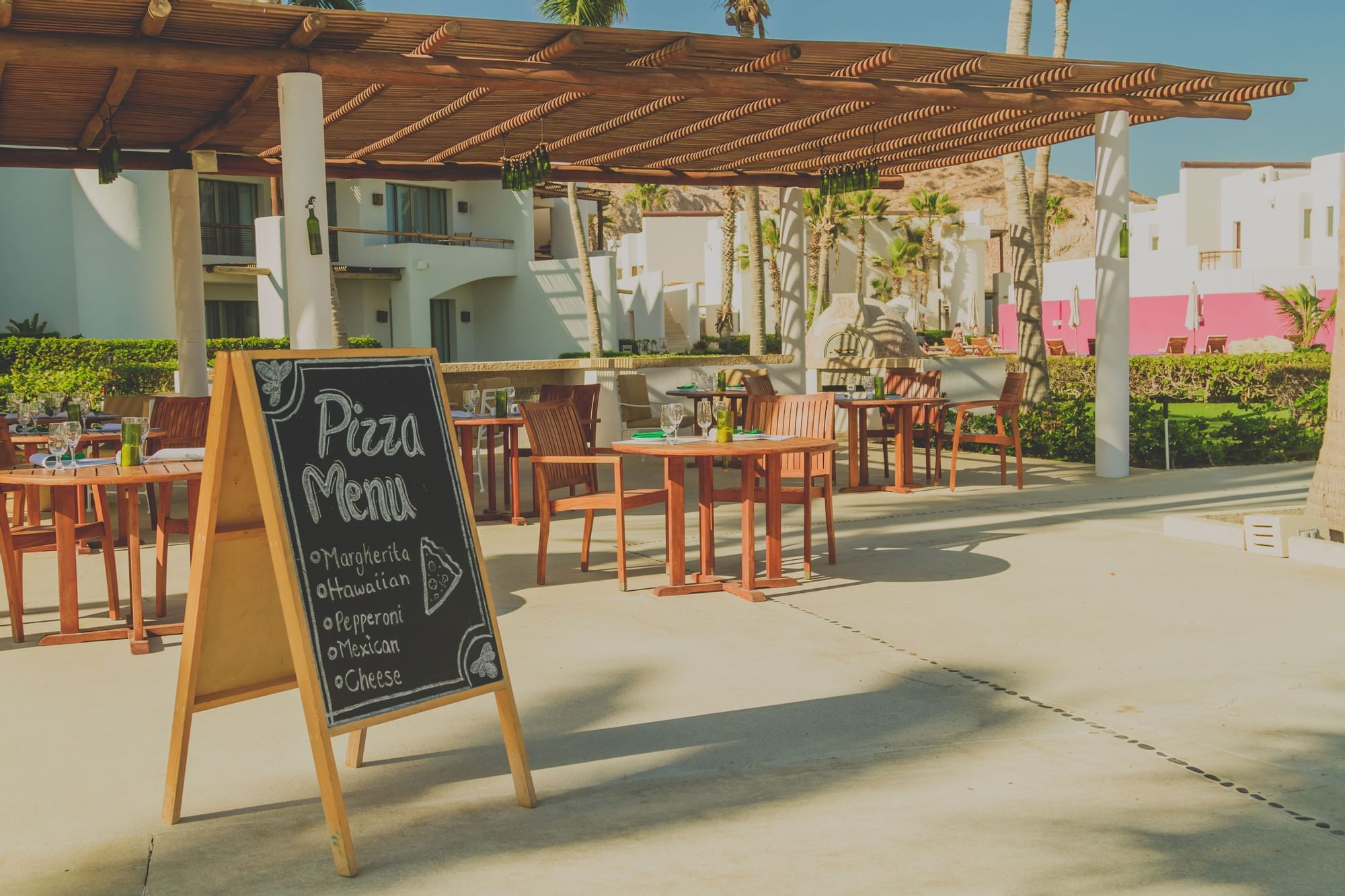 A chalk sign advertising pizza - Marquis Los Cabos