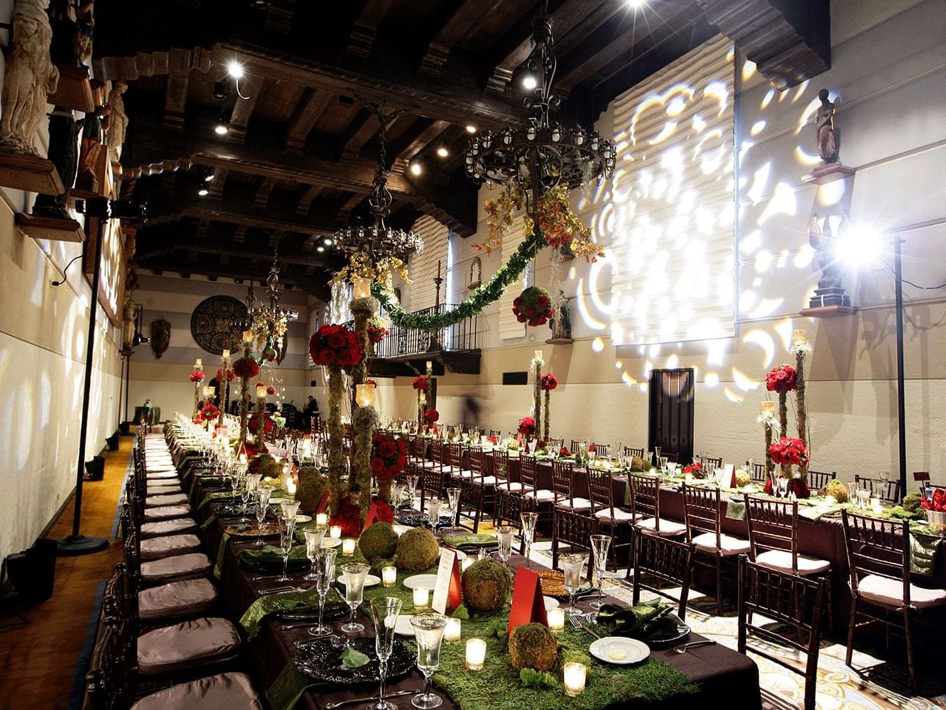 ballroom with long tables and flower/moss centerpieces