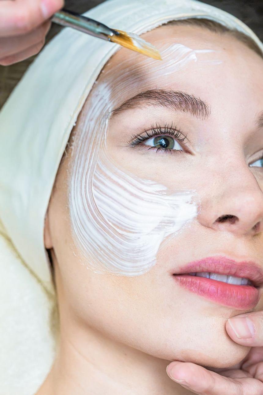 woman enjoying a facial at a spa