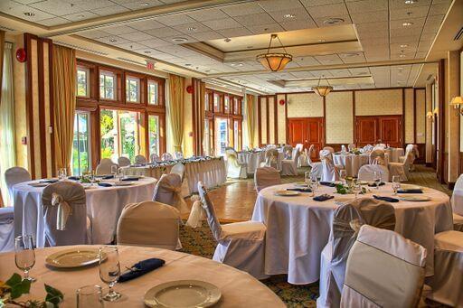 pink wedding tables in ballroom