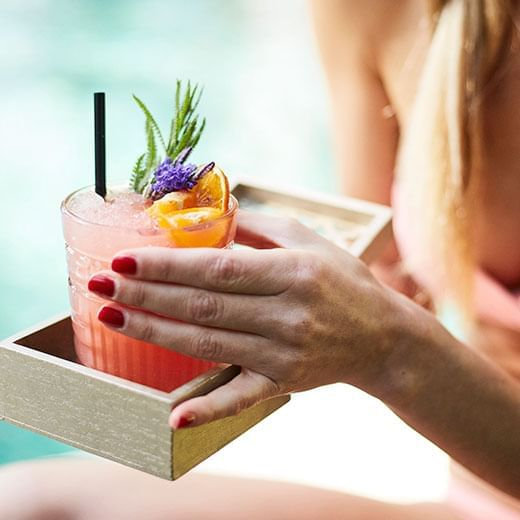 Lady holding a cocktail - Marbella Club