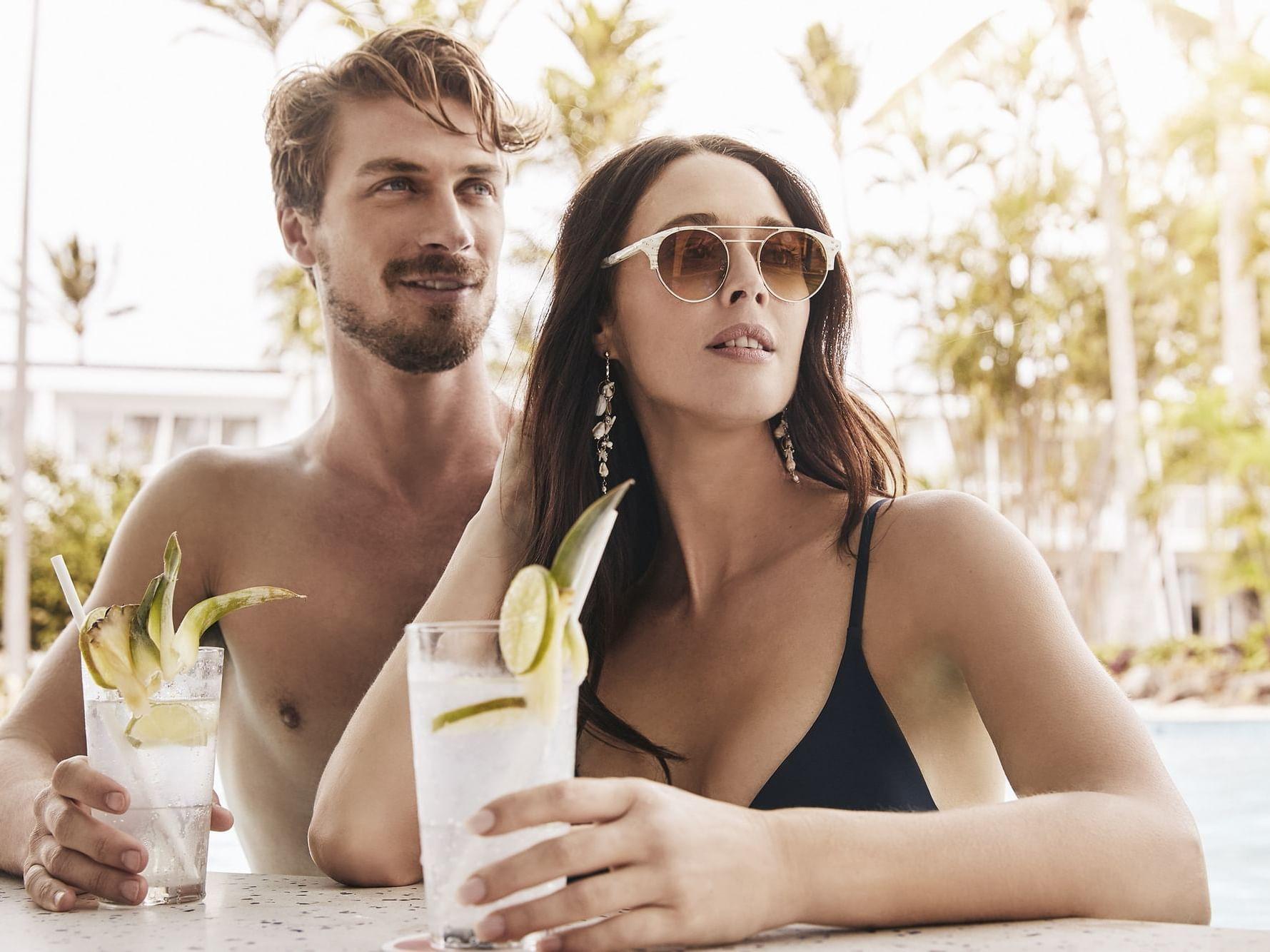 Couple having drinks in Bar Rumbah at Daydream Island Resort