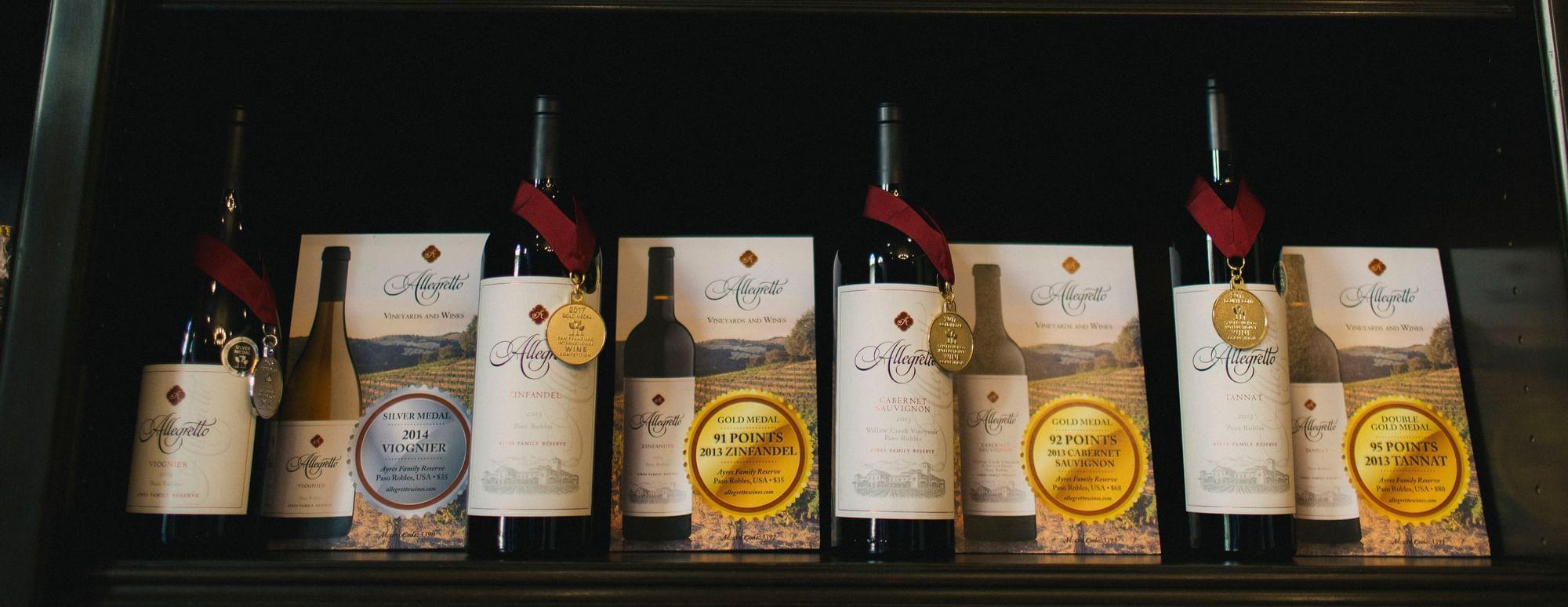Allegretto wine bottles lined up on shelves