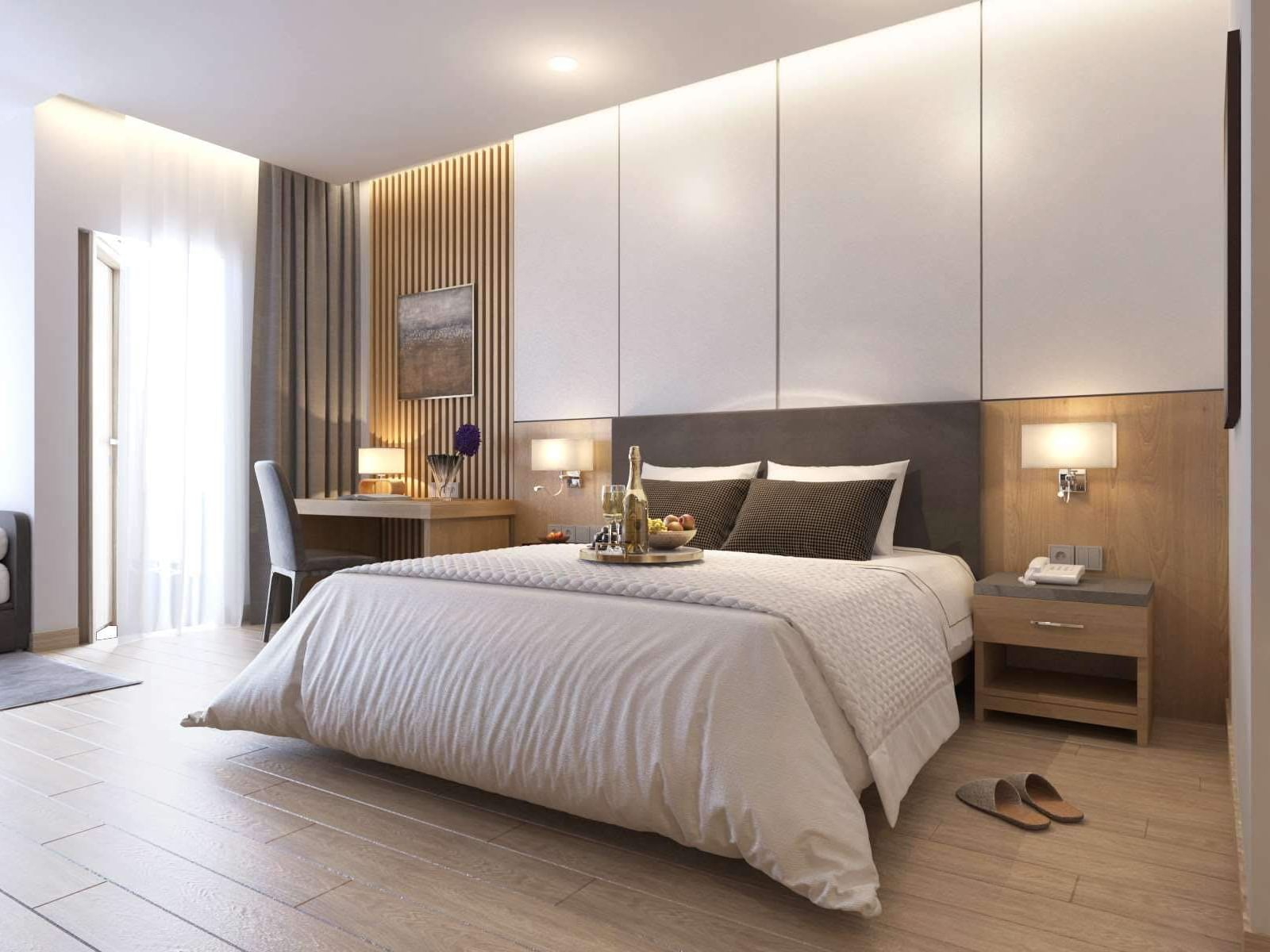 hotel room interior with king bed and modern furnishings