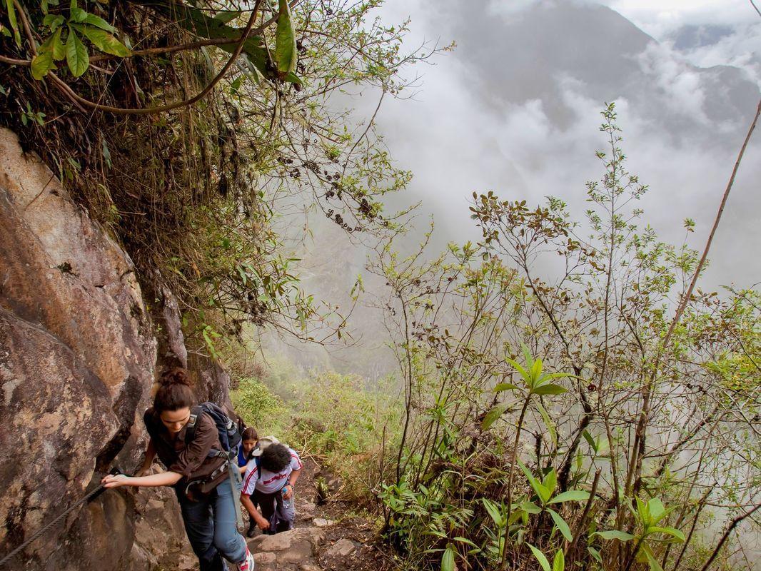 Tourists climbing the Machu Picchu Mountains near Hotel Sumaq