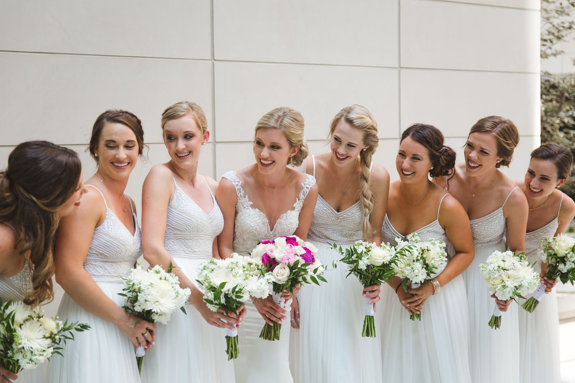 a group of brides maids holding flowers