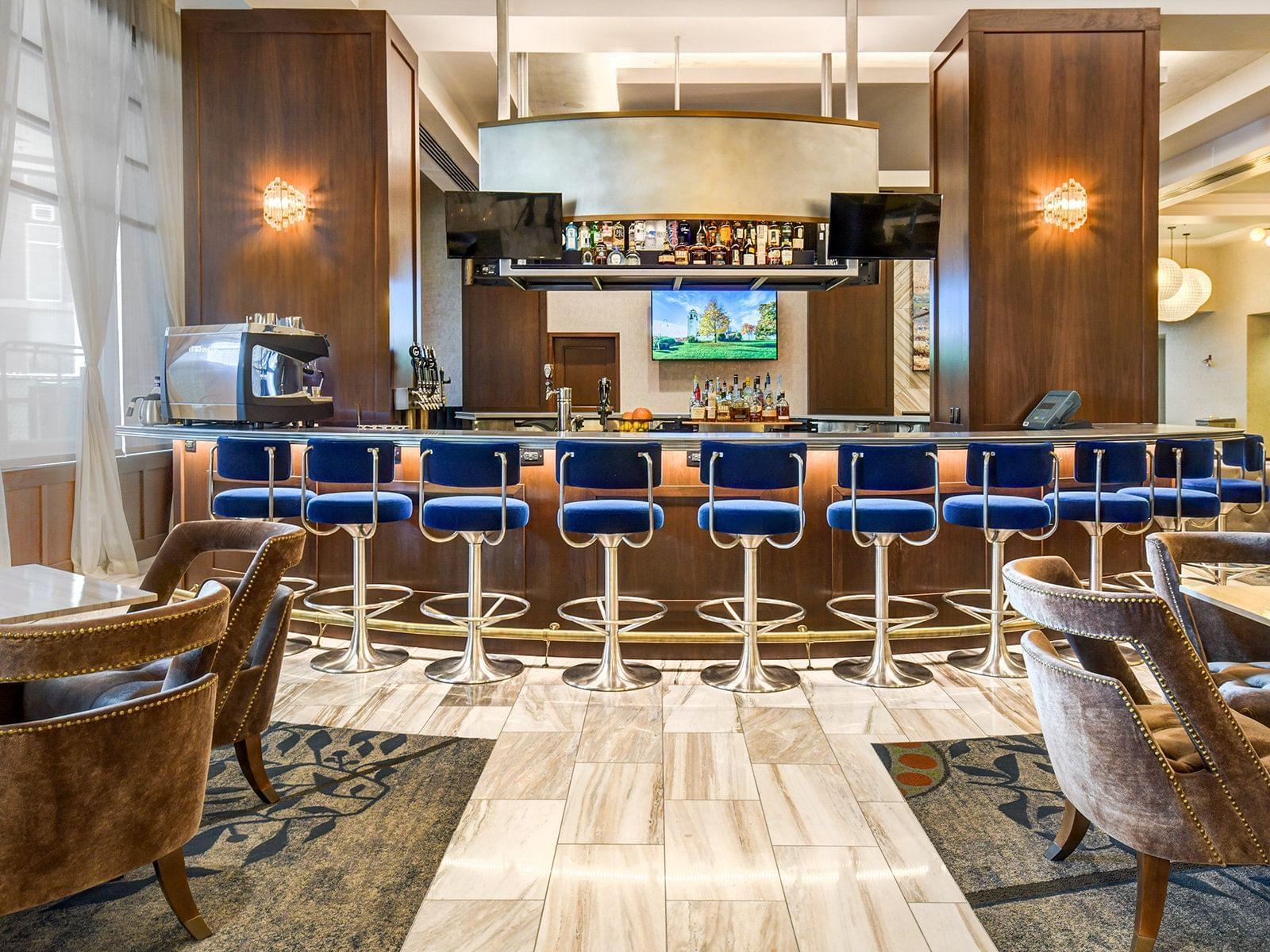 row of chairs at a bar