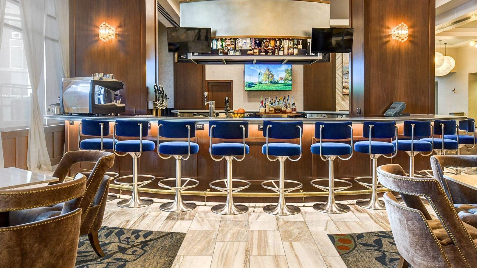 a row of bar stools at a bar