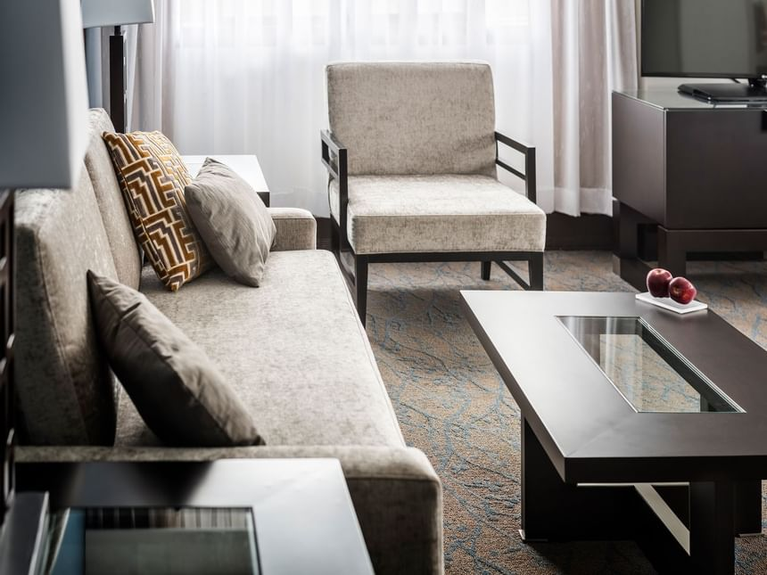 living room with sofa, accent table and coffee table
