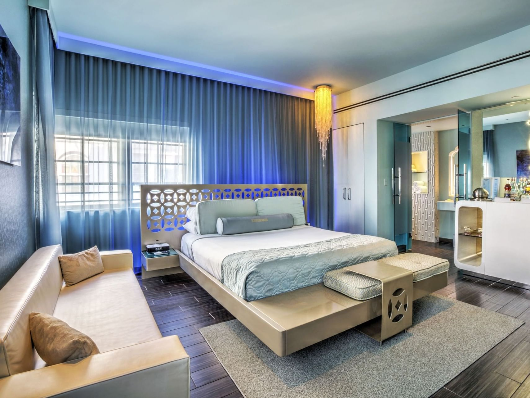 Gold Junior Suite with king bed & a sofa at Dream South Beach