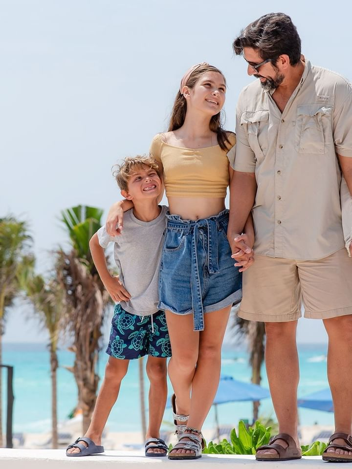 A family spending time at The Reef Playacar